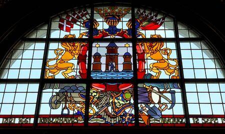 Coat of arms of the Danish Kingdom. Vitrage window in city hall of Copenhagen, Denmark.