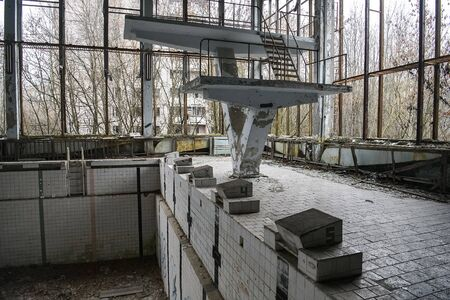 Abandoned Swimming Pool in in ghost town Prypiat in Chornobyl exclusion zone. Ukraine, Imagens