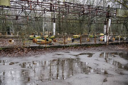 Abandoned amusement park in ghost town Prypiat in Chornobyl exclusion zone. Ukraine,