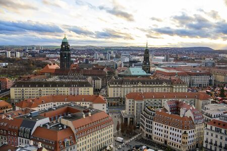 Panoramic view of Dresden city with old buildings at sunset from of lutheran church of Our Lady Frauenkirche, Germany.