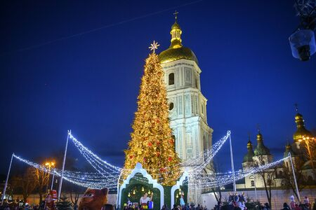 Brightly decorated Christmas Tree and St. Sophia bell tower on Sophia Square in Kyiv, Ukraine.  Stock Photo