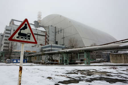 New Safe Confinement above remains of reactor 4 and the old sarcophagus at Chernobyl nuclear power plant. December 2016 Stock Photo