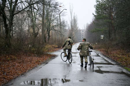 Police patrol in abandoned ghost town Prypiat, Chornobyl exclusion zone.
