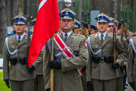 Servicemen of honor guard of Polish army during ceremonial events at Polish military cemetery Polish graves in Bykivnia near Kyiv. Ukraine. September 2012