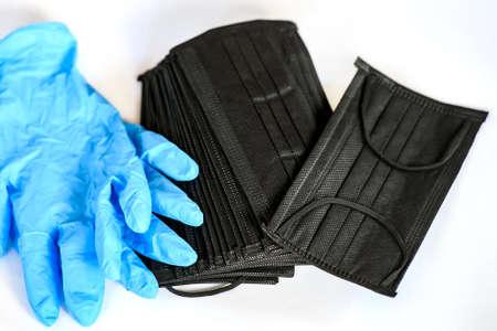Black medical protective masks with a carbon filter adn blue protective gloves. Stok Fotoğraf