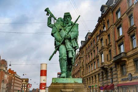 Private Soldier and Little Hornblower statue, bronze monument near Town Hall Square. Copenhagen, Denmark. February 2020
