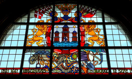 Coat of arms of the Danish Kingdom. Vitrage window in city hall of Copenhagen, Denmark.