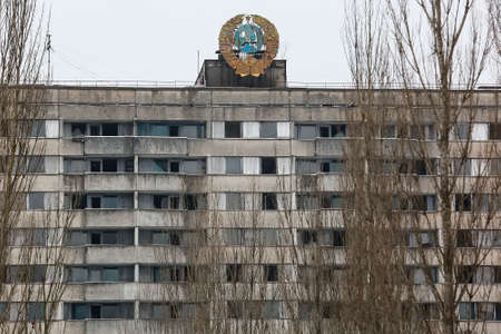Soviet coat of arms on building in abandoned city of Prypiat, near Chornobyl nuclear power plant, Ukraine