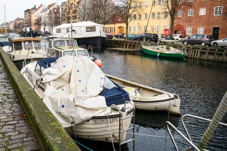 Boats and yachts on canal between Overgaden Oven Vandet and Overgaden Neden Vandet in Copenhagen, Denmark.