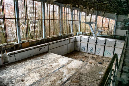 Abandoned Swimming Pool in in ghost town Prypiat in Chornobyl exclusion zone. Ukraine,