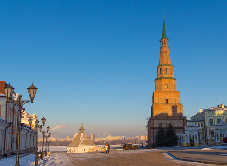 clear day in winter time: Kazan kremlin. The falling tower on relief against cityscape skyline. Editorial