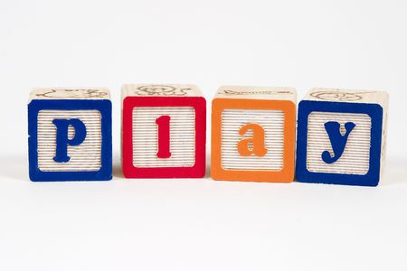 Play spelled out in childs blocks
