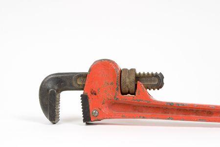 Orange pipe wrench close up detail