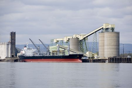 laden: ocean going ship being loaded with grain for export