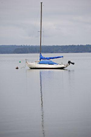 puget: Sailboat bouyed on Wasingtons Puget Sound Stock Photo
