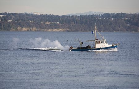 puget: Fishing boat under way in Puget Sound