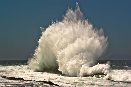 billow: breaking wave on ocean beach of South Africa