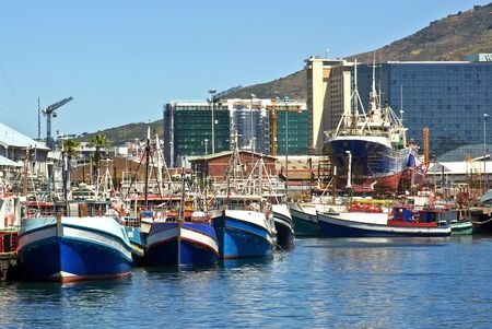 fishing seine vessel during reparing in dock of city ocean bay of Cape Town South Africa near mountains photo