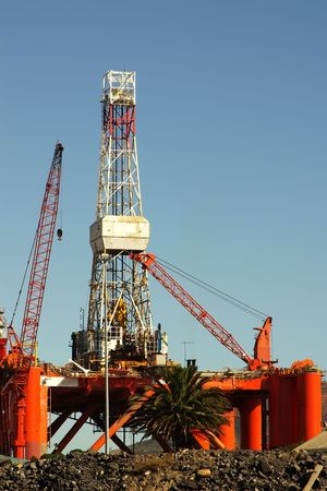 mining ships: oil- rig against blue sky. cape town, south africa