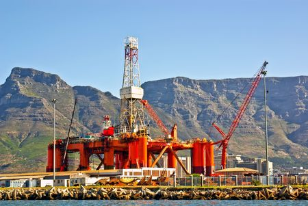 oil rig in the ocean bay of cape town, south africa photo