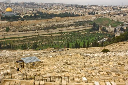 view to both sides of Kidron valley in Jerusalem. Ancient jewish cemetery, old city walls,  photo