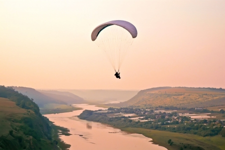 helmet seat: Air adventure - evening paragliding above the Dnister river canyon Stock Photo