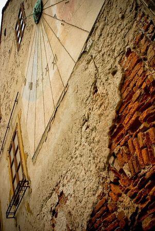 ancient sundial on the yellow stucco wall in Zagreb, Croatia photo