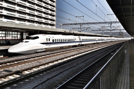 modern: The Shinkansen  new trunk line is a network of high-speed railway lines in Japan. This photo shows one of the bullet trains. Stock Photo