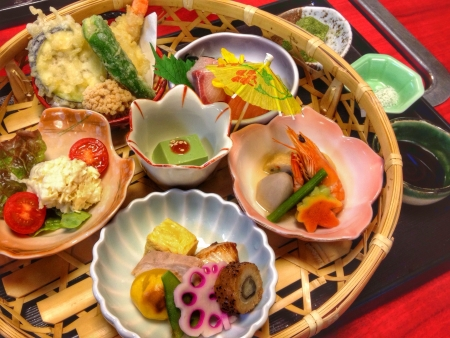 pricey: A quite pricey beautiful and sumptuous Japanese meal set served in a fine restaurant in Kyoto Japan. The food presentation works up an appetite. Japanese food always comes with an artistic touch. It is such a wonderful and delicious complete meal.