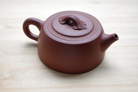 velours: dark-red enameled pottery teapot