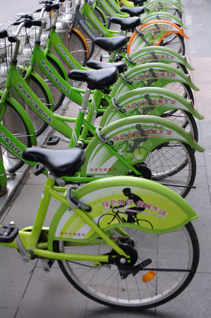 time specification: Shared bicycles at park close up