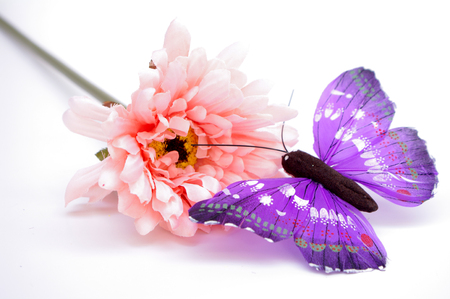 Artificial Gerbera with a butterfly