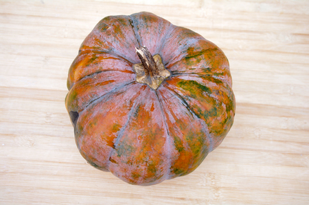 chafing dish: Top view of a pumpkin on wooden background