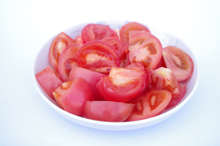 chafing dish: tomato in a plate on white background Stock Photo