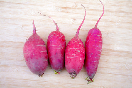 chafing dish: Radish on a wooden background