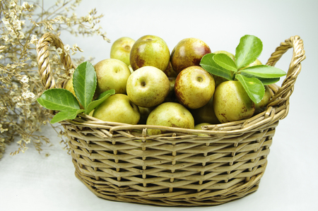 Winter jujube in a basket close up view