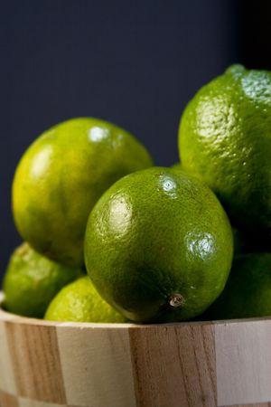 A basket full of lemons against black background Stock Photo