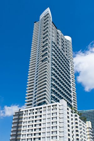 skyscraper detail against blue sky in South Florida Stock Photo