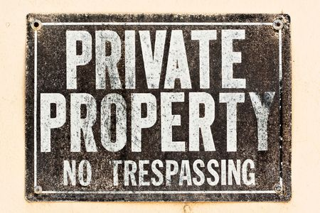 Distressed Private Property Sign on the wall