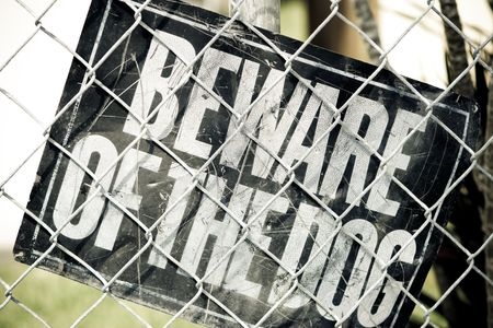 Beware of the Dog Sign inside a fenced urban area