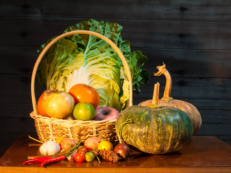 transgenic: Still life of mix vegetable arranged with basket on old wooden