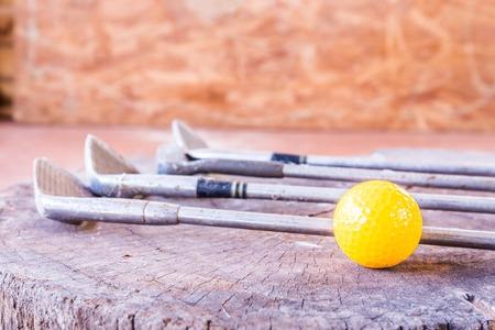 Still life Yellow Miniature Golf Ball On White Background. photo