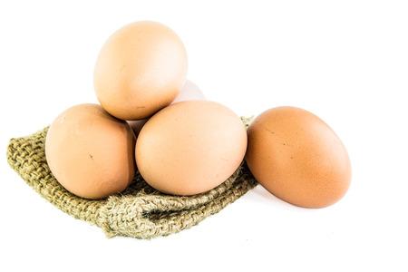 Fresh Egg With Burlap Sack Harvest on with background. photo