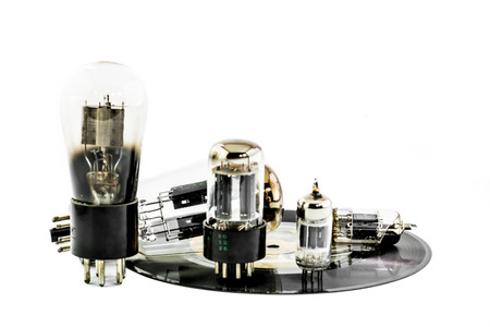 Vacuum electronic preamplifier tubes on platter . Isolated image on white background photo