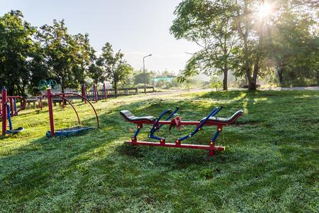 Exercise equipment in public park on sunrise. photo