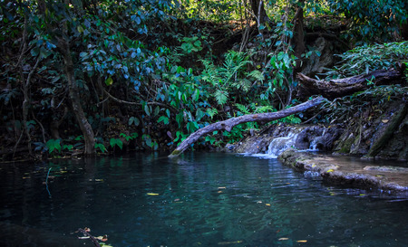 out of doors: Timber and limestone waterfall in Thailand Stock Photo