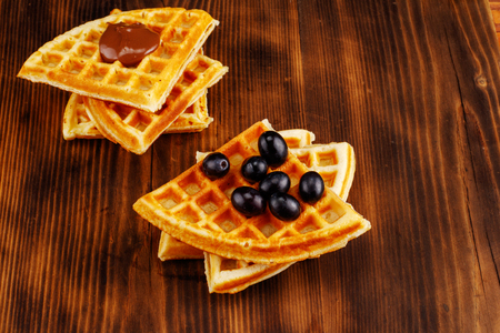 Homemade waffles on a wooden background
