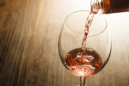 red wine pouring: Rose wine
