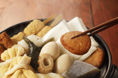 Japanese oden. vegetables, fish dumplings and various other articles of food stewed in a thin soy soup.