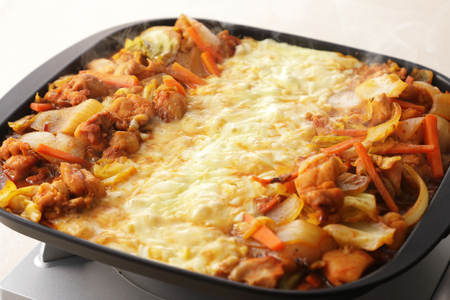 Cheese dak galbi Korean spicy food on hot pan